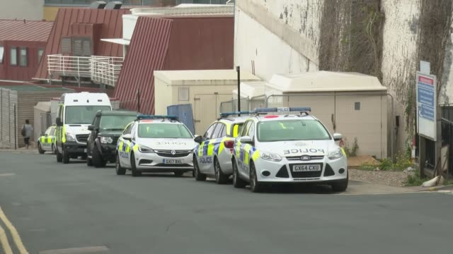 man arrested following stabbing at brighton hospital; england: brighton: ext gv police speaking to hospital staff and civilians outside building gv... - civilian stock videos & royalty-free footage