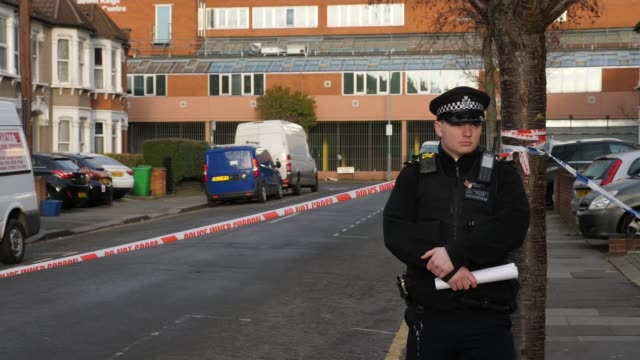 three men fatally stabbed in ilford england london ilford seven kings ext gvs of police officers and forensic tent in cordonedoff street - cordon boundary stock videos & royalty-free footage