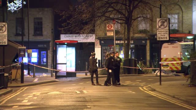 two men stabbed to death and woman shot in 3 separate incidents in capital england london hackney red police cordon tape tied to post at crime scene... - itv lunchtime news stock videos & royalty-free footage