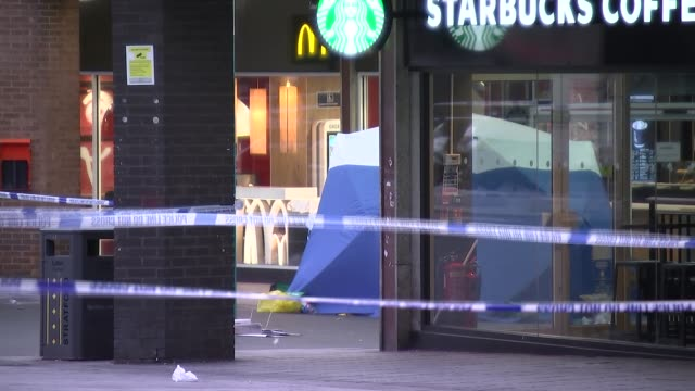 two teenagers stabbed to death within hours of each other england stratford stratford centre ext police cordon tape outside mcdonalds where baptista... - jackie long stock videos & royalty-free footage