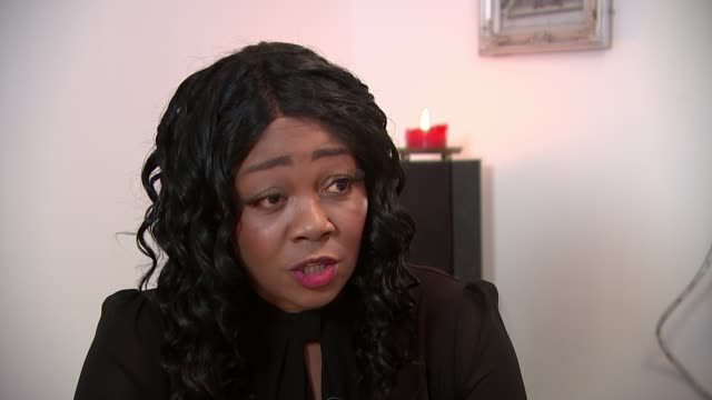 stockvideo's en b-roll-footage met woman calls for case updates for crime victims; england: london: int pastor lorraine jones looking at probation service statement on reporter's phone... - probatie