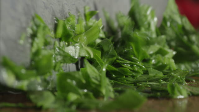 knife cutting basil. - basil stock videos & royalty-free footage