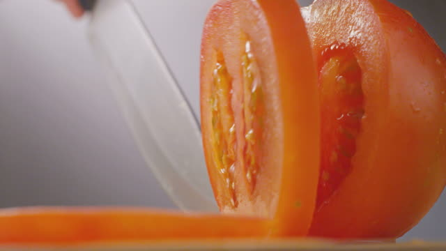 knife cutting tomato - chopped stock videos and b-roll footage
