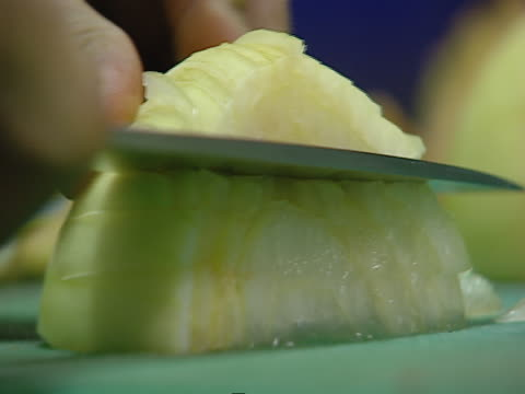 A knife slices and chops an onion.