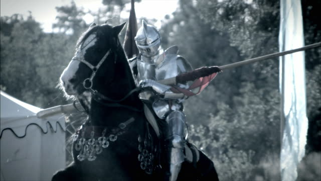 a knight and his horse prepare to joust. - jousting stock videos and b-roll footage
