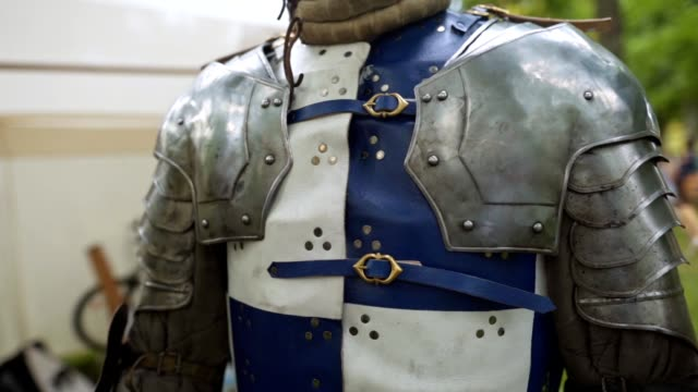 a knight in body armor on a traditional festival - reenactment stock videos & royalty-free footage
