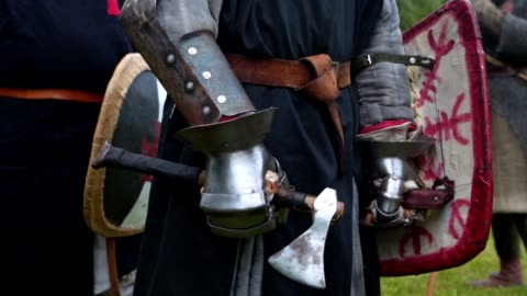 a knight in body armor with a long sword standing at a medieval festival - armoured vehicle stock videos & royalty-free footage