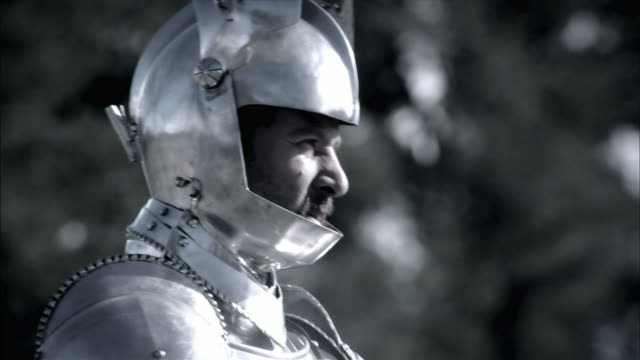 a knight lowers his visor and readies for a joust. - medieval stock videos & royalty-free footage