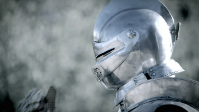 A knight pulls down his visor as he readies himself for a joust.