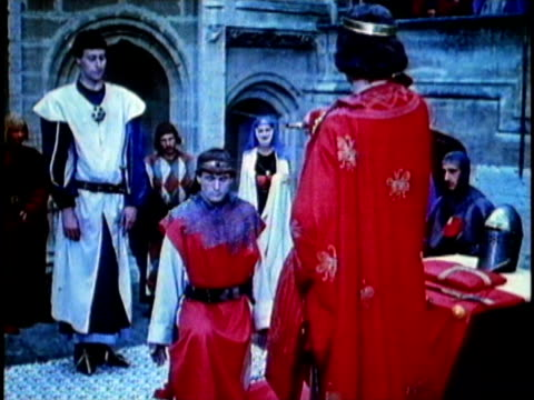 1956 reenactment montage knighting ceremony in castle court with medieval noblewomen waving handkerchiefs from balcony  - traditional ceremony stock videos & royalty-free footage