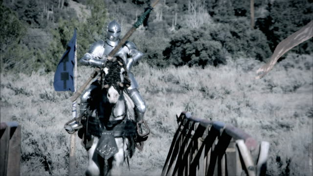 knights and their horses charge during a joust. - traditional helmet stock videos and b-roll footage
