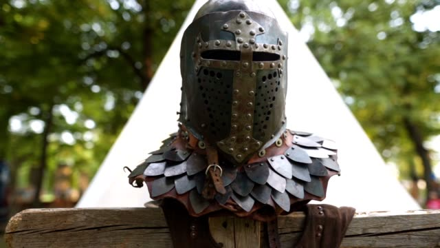knight's helmet on a stand at a traditional festival - traditional helmet stock videos and b-roll footage