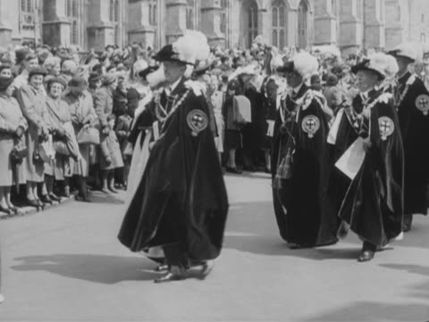 knights of the garter take part in their annual service at windsor castle. - cavalleria video stock e b–roll