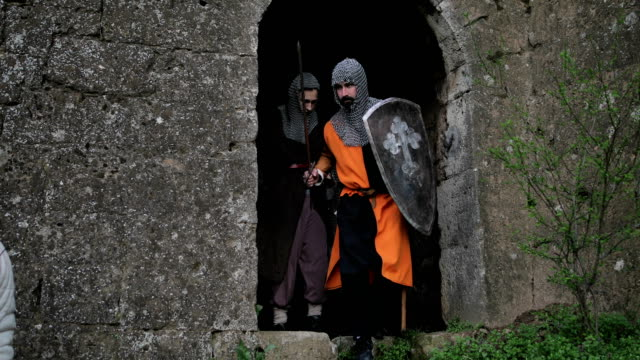 knights start to battle. medieval fortress - periodo medievale video stock e b–roll