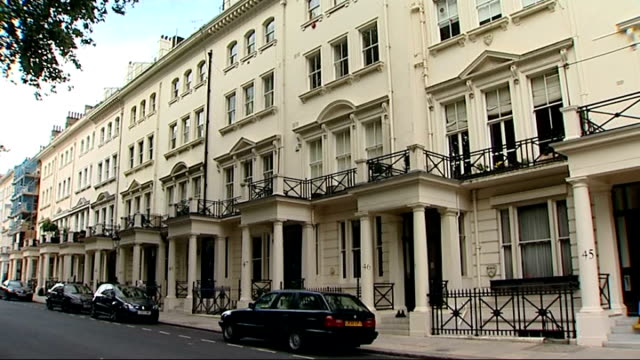 knightsbridge and savile row general views black sports car parked in road / white painted terraced mansion block / tailor shops along savile row... - savile row stock videos and b-roll footage
