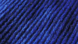 Knitted fabric in blue color. Can be used as background