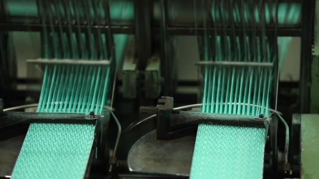 knitting machine is knitting the strap bag. - knitting stock videos & royalty-free footage