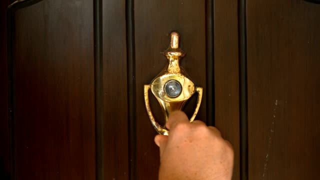knocking door by a man close up shot - door knocker stock videos & royalty-free footage
