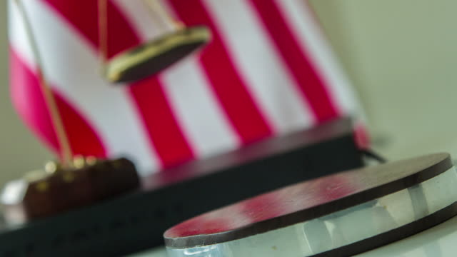 Knocking wooden gavel with American flag background