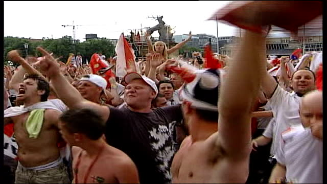 Knockout matches GERMANY Stuttgart EXT Crowd of England football fans celebrating and singing after win over Ecuador SOT Football's coming home