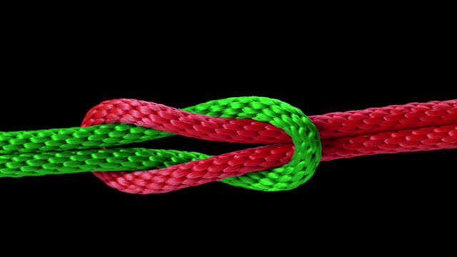 slo mo ld knot being tied with a red and green rope - rope stock videos & royalty-free footage