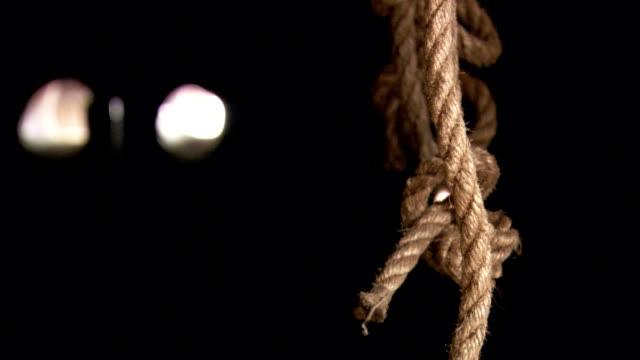 knotted ropes swing aboard a rocking ship. available in hd. - hanging stock videos & royalty-free footage