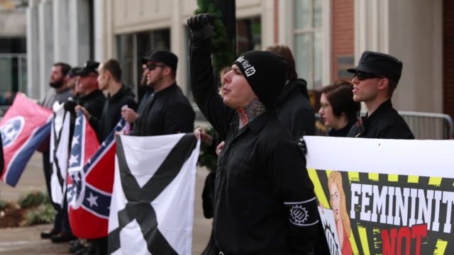 members of traditionalist worker party a neo nazi white nationalist group hold rally near krutch park to protest against the women's march sunday... - racism stock videos and b-roll footage