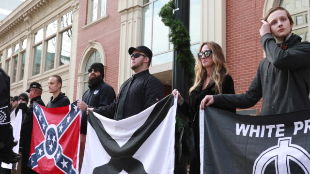 members of traditionalist worker party a neo nazi white nationalist group hold rally near krutch park to protest against the women's march sunday... - confederate flag stock videos & royalty-free footage