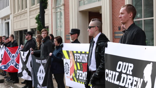 members of traditionalist worker party a neo nazi white nationalist group hold rally near krutch park to protest against the women's march sunday... - nazi rally stock videos and b-roll footage