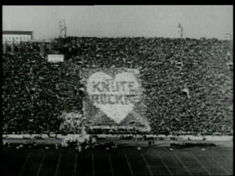 knute rockne smiling / knute rockne spelled out by fans in stands / 1923 players on field in slow motion at notre dame vs. army football game - 1949 stock videos & royalty-free footage