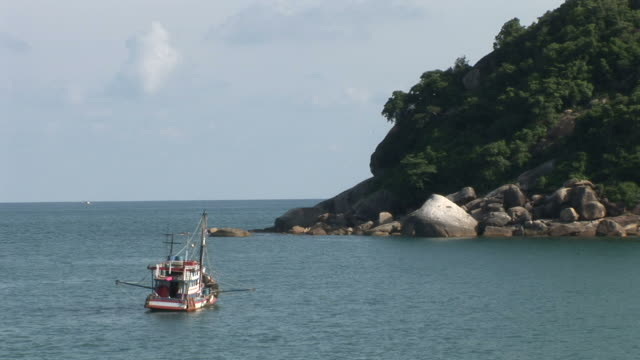 ko samui, thailandview of a boat anchoring in the sea at ko samui thailand - ko samui stock videos & royalty-free footage