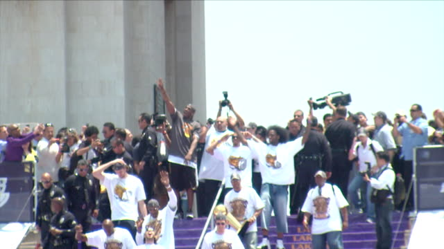 kobe bryant and the 2009 nba championship lakers enter the la memorial coliseum to a jubilant crowd - kobe bryant stock videos & royalty-free footage