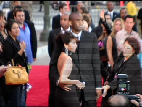 kobe bryant and wife vanessa at the 2004 american music awards red carpet at the shrine auditorium in los angeles, california on november 14, 2004. - shrine auditorium stock videos & royalty-free footage