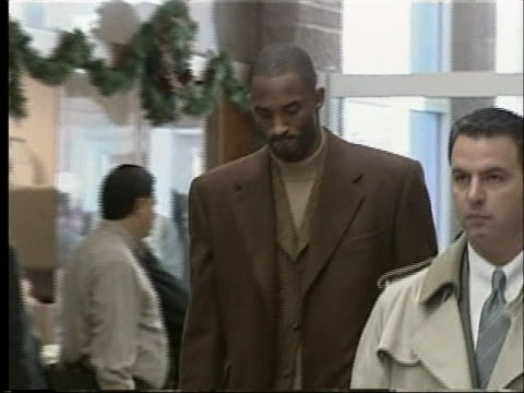 kobe bryant arrives at the courthouse during his trial for sexual assault - sport stock-videos und b-roll-filmmaterial