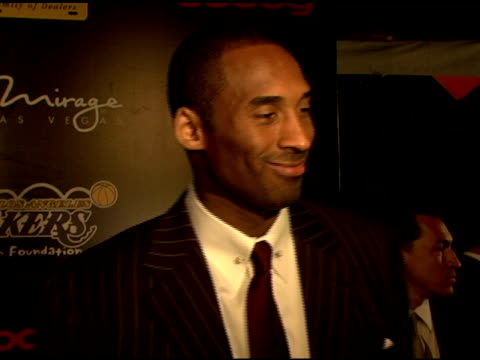 kobe bryant on gambling at the event for a good cause getting involved in all the things the lakers foundation does working with tyoung kids helping... - kobe bryant stock videos & royalty-free footage