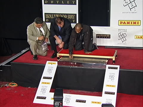 kobe bryant writes his name in concrete at grauman's chinese theatre in hollywood, california. kobe bryant will become the first athlete to put his... - tcl chinese theatre stock videos & royalty-free footage