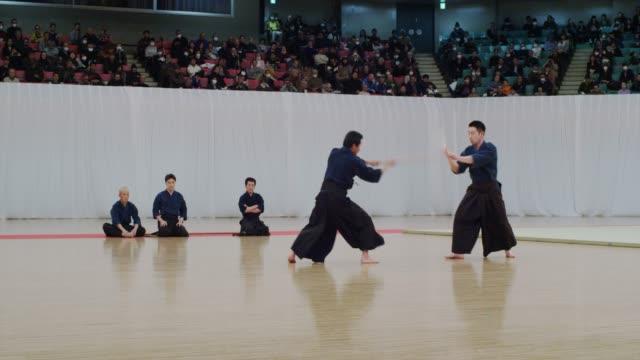 42 kobudo (ancient martial arts) demonstration at budokan tokyo - insel honshu stock-videos und b-roll-filmmaterial