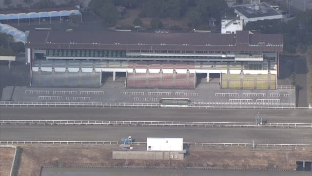 kochi racetrack and its viewing stand in kochi - pferderennbahn stock-videos und b-roll-filmmaterial