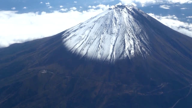 wintry weather finally made an appearance atop mount fuji, where snow was observed for the first time this season. the kofu local meteorological... - mt fuji stock videos & royalty-free footage