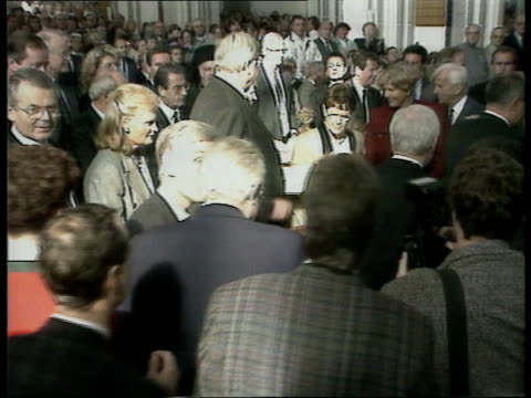 kohl leads second unification anniversary celebrations germany lagv church as bells ringing schwerin ms german chancellor helmut kohl along towards... - priest stock videos & royalty-free footage