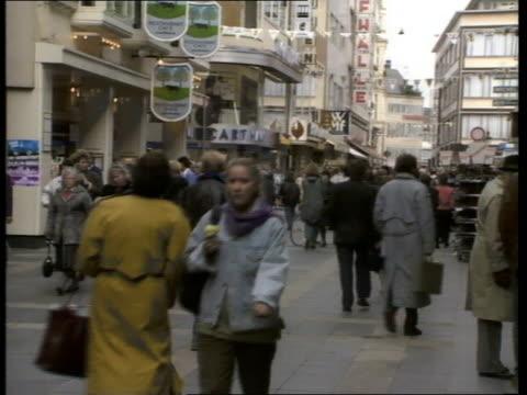 kohl parliament speech / reaction:; west germany: bonn: bundestag: cms hans klein intvw sof ext cms green tram towards & past cms people walking in... - 西ドイツ点の映像素材/bロール