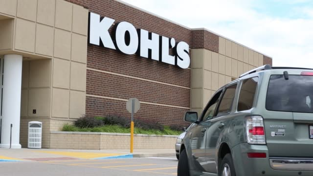 a kohl's store stands in peru il on august 4 2017 shots wide shot of kohl's with car passing in foreground tighter shot of same subject as pedestrian... - kohls stock videos & royalty-free footage