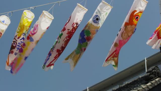 koinobori carp streamer at boys festival - kindertag stock-videos und b-roll-filmmaterial