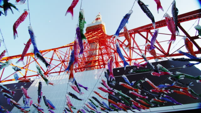 koinobori carp streamer at boys festival with tokyo tower - traditionell festival stock-videos und b-roll-filmmaterial