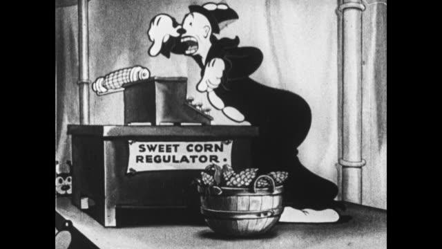 koko the clown demonstrates an invention to eat corn on a typewriter - schreibmaschine stock-videos und b-roll-filmmaterial