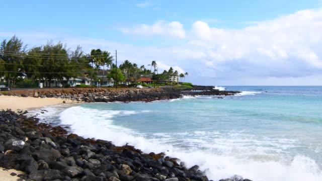 Koloa Kauai Hawaii beautiful beach at Brenneck;s Beach with rocks and waves 4K