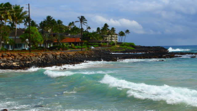 Koloa Kauai Hawaii beautiful beach at Brenneck;s Beach with rocks and waves, 4K