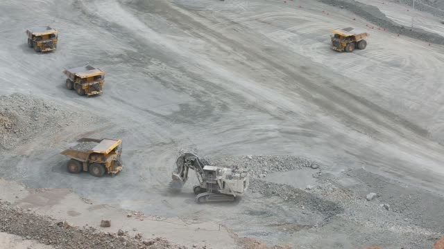 a komatsu ltd dump truck transports raw ore out of an open pit at the oyu tolgoi copper gold mine jointly owned by rio tinto groups turquoise hill... - caterpillar inc video stock e b–roll