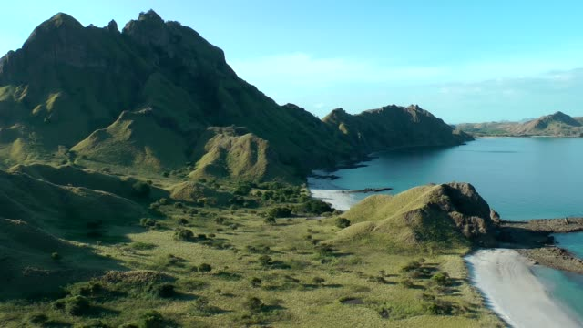 komodo bay filmed from high with mountain and sea komodo archipelago - insel komodo stock-videos und b-roll-filmmaterial