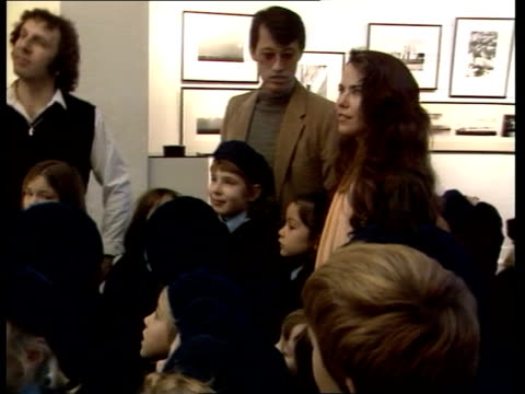 england ms koo stark actress and aquaintance of prince london andrew with group of school children mayfair ms photographers walking about - koo stark stock-videos und b-roll-filmmaterial